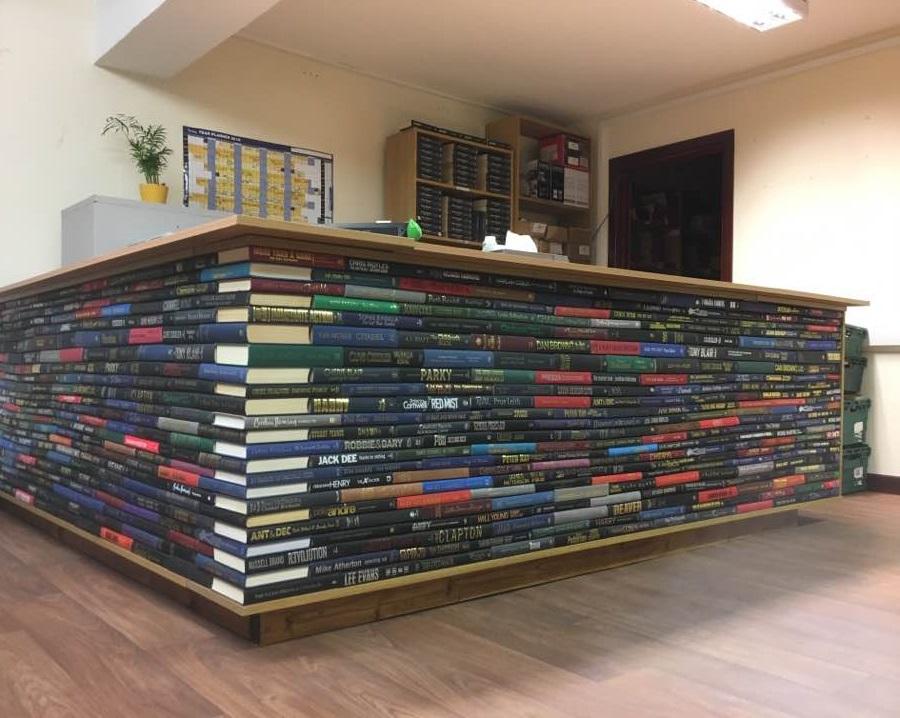 desk made of used hard back books